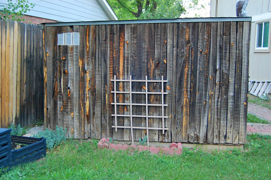 Tool shed covered with reclaimed fencing | Happy Simple Living blog