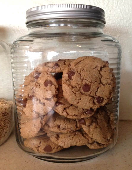 A cookie jar full of chocolate chip cookies at Happy Simple Living blog