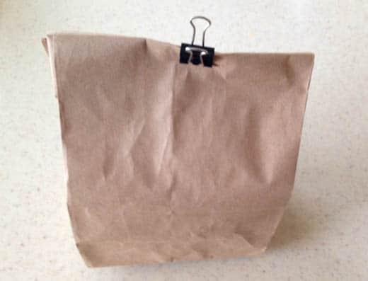Steam a red bell pepper in a paper bag